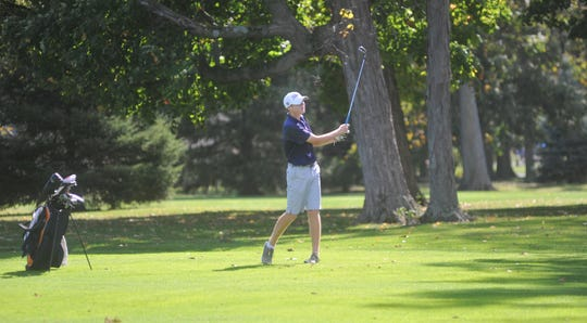 Galion's Bronson Dalenberg hits an approach shot on the 10th hole at Sycamore Creek.