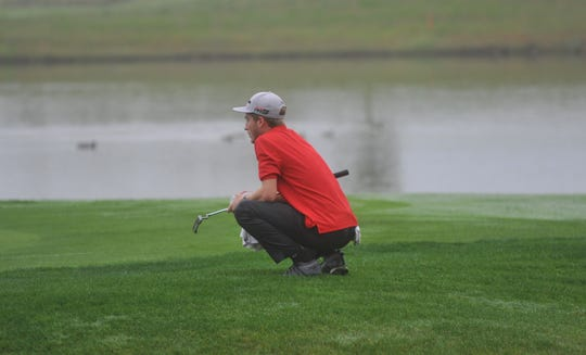 Bucyrus' Reece Zeigler waits for his playing mates to hit onto the green.