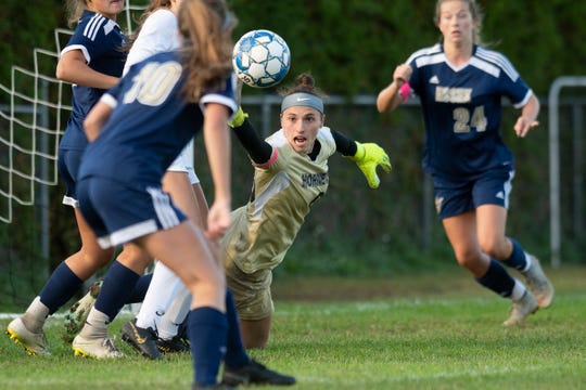 Essex goalie Rachel Botala (00) makes a save during the girls soccer game between the Burlington Sea Horses and the Essex Hornets at Essex High School on Wednesday afternoon October 2, 2019 in Essex, Vermont.