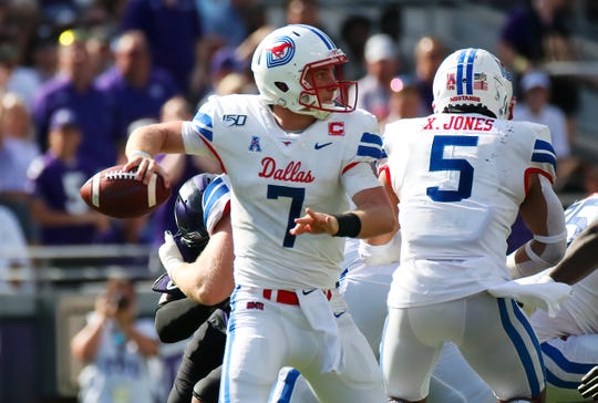 Sep 21, 2019; Fort Worth, TX, USA; Southern Methodist Mustangs quarterback Shane Buechele (7) throws during the first half against the TCU Horned Frogs at Amon G. Carter Stadium.