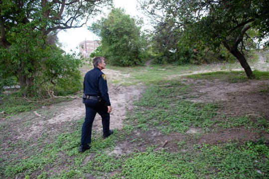 Corpus Christi Assistant Chief of Police Mark Schauer walks threw Blucher Park on Monday, Sept. 30, 2019. City Council passed an ordinance that prohibits activities such as lying down and eating, among other things.