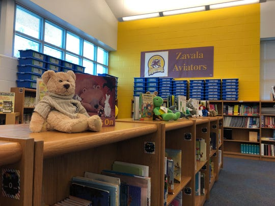 The library at Zavala Elementary School. The school, which has an economically disadvantaged student population of 98%, won a $16,000 grant to give books to students.