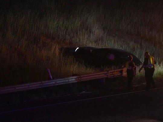 Corpus Christi police officers respond to a car wreck involving a motorcycle near Redbird Lane in Calallen.