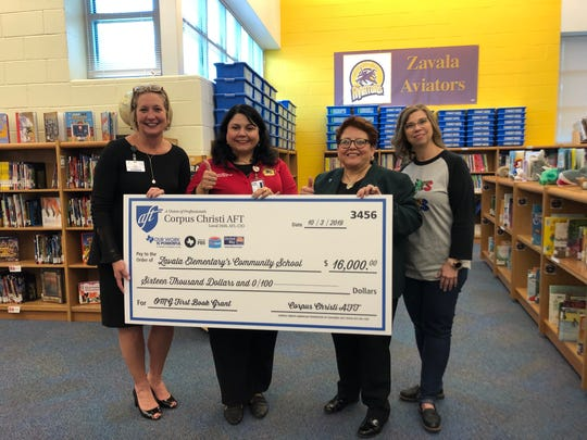 Nancy Vera, president of the Corpus Christi American Federation of Teachers, presents a $16,000 grant to Zavala Elementary to give each student at least two books. From the left are Corpus Christi Independent School District chief of staff Kimberly James, Zavala Principal Judith Hinojosa, Vera and Zavala librarian Lisa Sullivan.