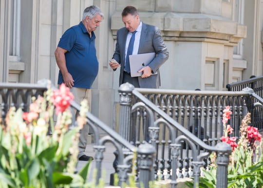 Jeffery L. Webb talks with his lawyer outside the Ross County Courthouse after pleading guilty to two counts of rape of a victim less than 13 years old in front of Judge Michael Ater on Oct. 3, 2019. Webb is scheduled to be sentenced on Nov. 15.