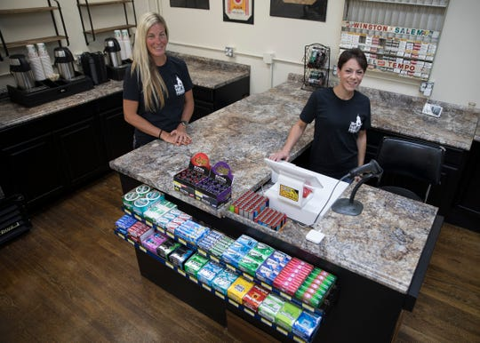 Paint Street Provisions owner Amanda Scott, left, and manager Sara Bost will be two new faces downtown as they are setting up their new convenience store that is due to have its grand opening on Oct. 17, 2019.