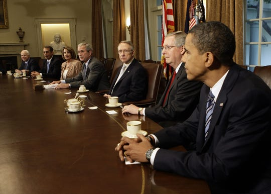 Sept. 25, 2008 -- President George W. Bush meets with Congressional leaders and the presidential candidates at the White House on Thursday, Sept. 25, 2008. From left: Sen. John McCain (R-Ariz.) House Minority Leader John Boehner (R-Ohio); House Speaker Nancy Pelosi (D-Calif.); President Bush; Senate Majority Leader Harry Reid (D-Nev.); Senate Minority Leader Mitch McConnell (R-Ky.); and Sen. Barack Obama (D-Ill.).
