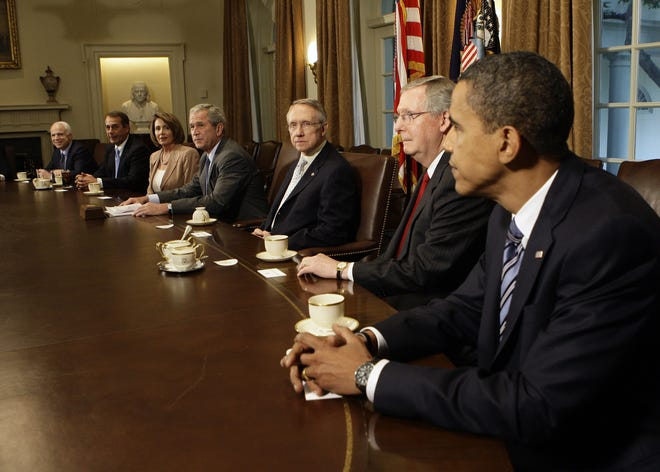 Sept. 25, 2008 -- President George W. Bush meets with Congressional leaders and the presidential candidates at the White House on Thursday, Sept. 25, 2008. From left: Sen. John McCain (R-Ariz.) House Minority Leader John Boehner (R-Ohio); House Speaker Nancy Pelosi (D-Calif.); President Bush; Senate Majority Leader Harry Reid (D-Nev.); Senate Minority Leader Mitch McConnell (R-Ky.); and Sen. Barack Obama (D-Ill.).