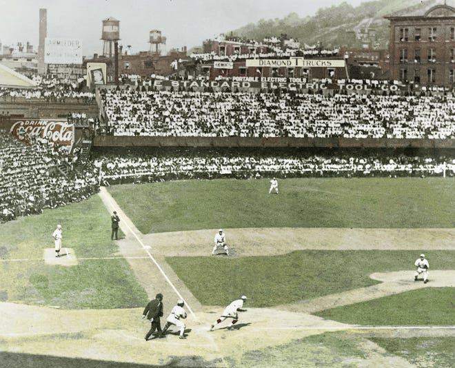 A colorized photo of action at Redland Field during the 1919 World Series between the Cincinnati Reds and Chicago White Sox.
