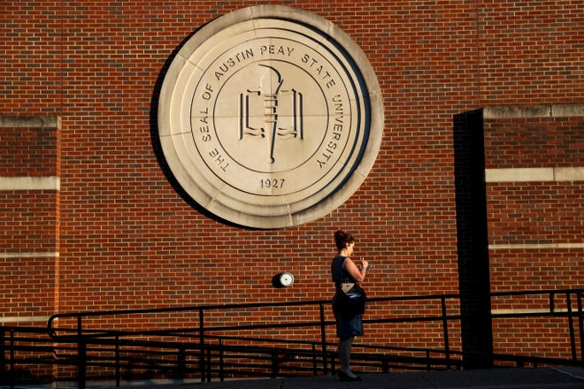 A woman stands outside the Austin Peay Morgan University Center in Clarksville on Oct. 3.