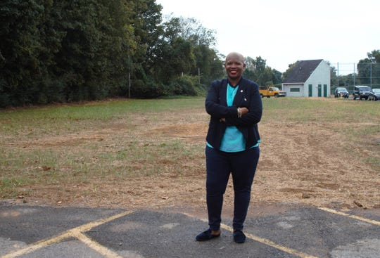 Commissioner Leverett in front of of the new grass covered lot.