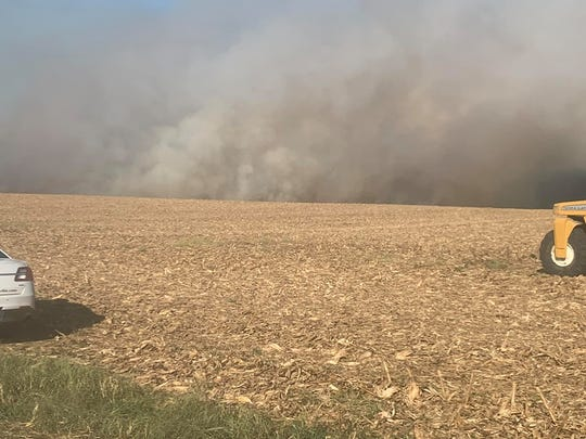 A brush fire burns around the railroad tracks north of Clarksville on Thursday afternoon, Oct. 3, 2019.