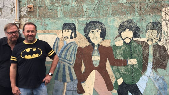 "Dennis Diken and Jim Babjak of The Smithereens in front of a Beatles ""Yellow Submarine"" mural that Babjak painted in the mid-'70s on the back of his father's bar."