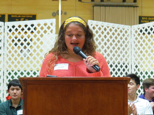 Judy Minnium of Scotch Plains, a senior at Wardlaw+Hartridge School, shares some of her favorite memories during a speech to the Lower School students.