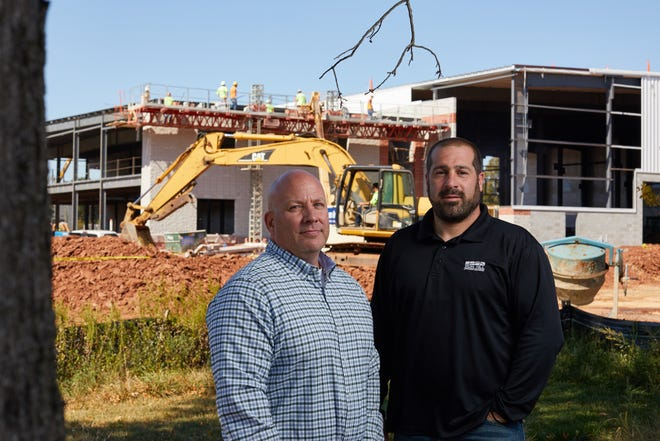 (Left to right) Mark Waddell, project manager, and  Jason Colatosti, site superintendent.