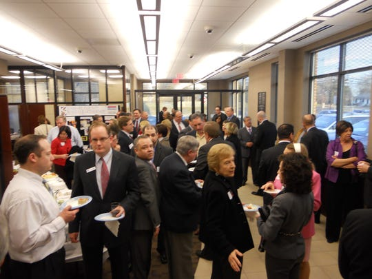 Business people gather at a recent networking event.