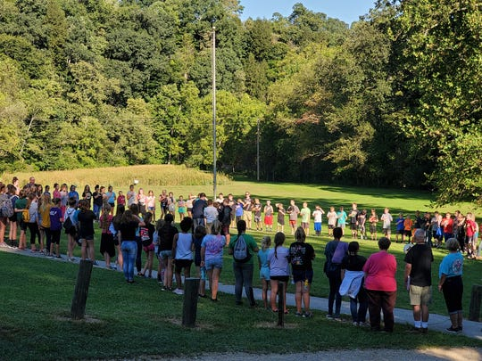 Flag ceremonies are part of the 40 year tradition of sixth grade camp for River View Local Schools.