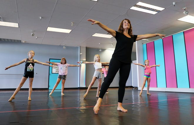 Jennifer Nelson leads a class at her dance studio, Miss Jennifer's Dance Studio on Second Street in Coshocton. Nelson started her studio in 1998 after dancing with a travelling Disney production.