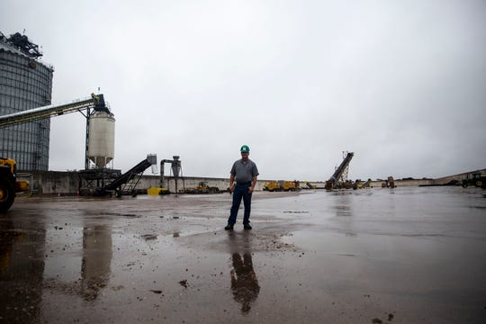 Kelly Nieuwenhuis, a farmer and Siouxland Energy Cooperative board of directors chairman, stands in the empty corn storage bunker that would soon be filled with corn from this season's harvest if the plant had not halted production on Wednesday, Oct. 2, 2019, outside of Sioux Center.