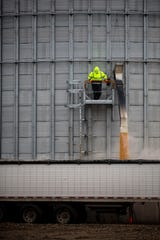 An employee at Siouxland Energy Cooperative monitors the flow of corn out of one of the ethanol plant's storage bins and into a truck to be sold elsewhere while the plant sits idle on Wednesday, Oct. 2, 2019, outside of Sioux Center. Siouxland's board of directors chose to halt ethanol production after the Environmental Protection Agency granted 31 waivers to small oil refiners allowing them to not blend ethanol in their gasoline.