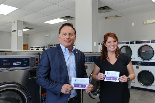 Secretary of State Paul Pate poses with Jennifer Krohn, co-owner of multiple Des Moines-area laundromats.