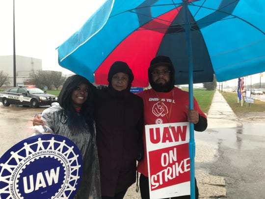 Ghana Goodwin-Dye, former president of UAW Local 909, is on a picket line on Mound Road near the closed GM Warren Transmission plant on Oct. 2, 2019. Goodwin-Dye, center, is standing with Angela Powell, a Ford-UAW worker, and Gary Grant, a UAW worker at Fiat Chrysler Automobiles.