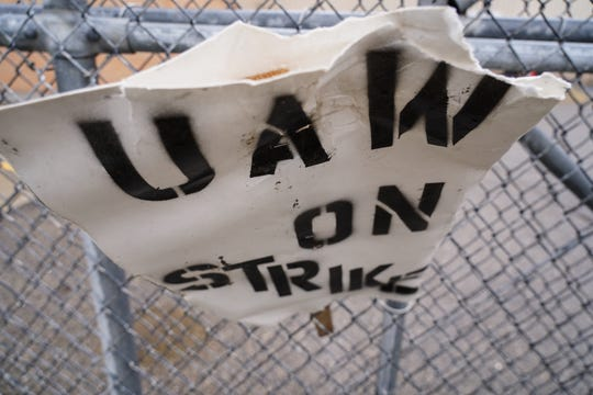 A UAW strike sign sits attached to a fence outside of General Motors Flint Assembly on Wednesday, October 2, 2019.