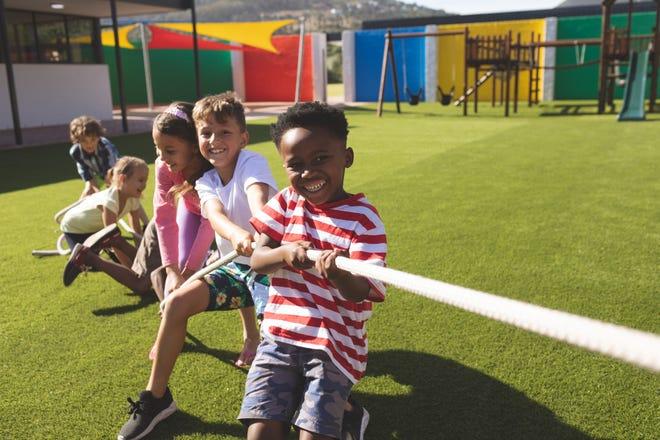 Kids playing tug of war on a playground