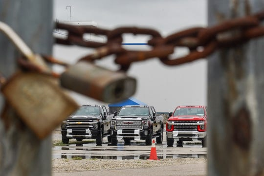 New trucks are seen parked outside of the Body Shop at Flint Assembly on Thursday, October 3, 2019.