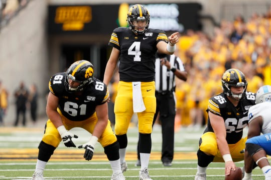Iowa quarterback Nate Stanley (4) has attempted 136 straight passes without an interception.