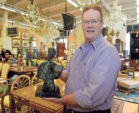 Jim Fuester with his 1956 bronze figure.