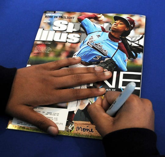Little-known media company Maven, Sports Illustrated's new manager, says the sports magazine is cutting more than 40 jobs out of a staff of 150.
