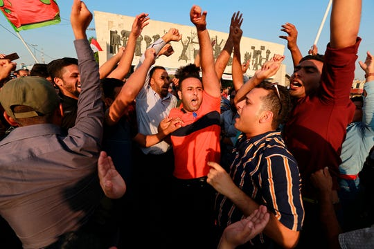 Iraqi protesters chant slogans demanding services and jobs during a demonstration in Tahrir Square, in central Baghdad, Iraq, Friday, Sept. 27, 2019.