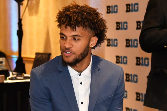 Michigan's Isaiah Livers talks to reporters during the Big Ten media day.