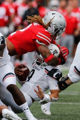 Ohio State defensive end Chase Young, top, leads the nation with eight sacks.