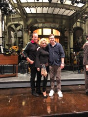 """Gary, Enid and Brandon Goodman on the stage at """"Saturday Night Live."""""""