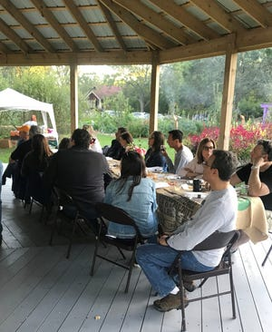 Twenty couples gathered at Detroit Abloom in the city's Jefferson-Chalmbers neighborhood last week to give back, share a meal and spend time together.