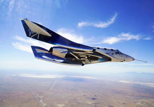 FILE - In this May 29, 2018 photo provided by Virgin Galactic, the VSS Unity craft flies during a supersonic flight test. Virgin Galactic said Wednesday, Oct. 2, 2019 that it has been contracted by the Italian air force for a suborbital research flight aboard its winged rocket ship.