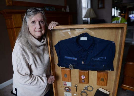 Sharon Larkins, 74, with the police items of her late husband Scott Larkins who died in the line of duty.**Sharon Larkins, widow of deceased Detroit cop Scott Larkins, who was shot in 1978 and died from his injuries in 2008. October 3, 2019. Harper Woods, Mi. (Clarence Tabb, Jr./The Detroit News)