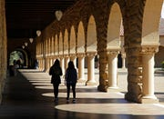 In this March 14, 2019, file photo students walk on the Stanford University campus in Santa Clara, Calif. When college students paying their own way have a financial hiccup, they have to make hard choices about how to spend their limited funds, and some turn to their food budget to close a gap.
