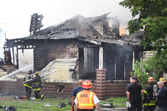 Firefighters work on putting out the house fire on Whittaker near Mullane in Detroit,  Thursday afternoon.