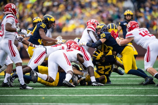 Walk-on Tyler Cochran (28) forced and recovered a fumble in Saturday's rout of Rutgers.