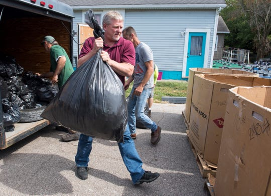 Mike Miller from Poplar Bluff, MO., unloads bags of plastic caps at Green Tree Plastic in Evansville, Ind., Wednesday, Sept. 25, 2019. 2030 lb. of plastic caps were collected in six months by children at W. E. Sears Youth Center in Missouri who participates in Green Tree Plastics ABC promise partnership program. Miller and other volunteers made the trip to Evansville to unload caps and pick up 10 plastic benches for W. E. Sears Youth Center.