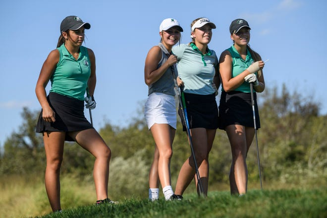 North sophomores Reagan Sohn, from left, Destynie Sheridan, Faith Johnson and Chloe Johnson watch senior Abby Whittington, not pictured, tee off during a practice round at Victoria National Golf Club in Newburgh, Ind., Wednesday afternoon, Oct. 2, 2019. The team will compete for another state championship at Prairie View Golf Club in Carmel, Ind., this weekend.