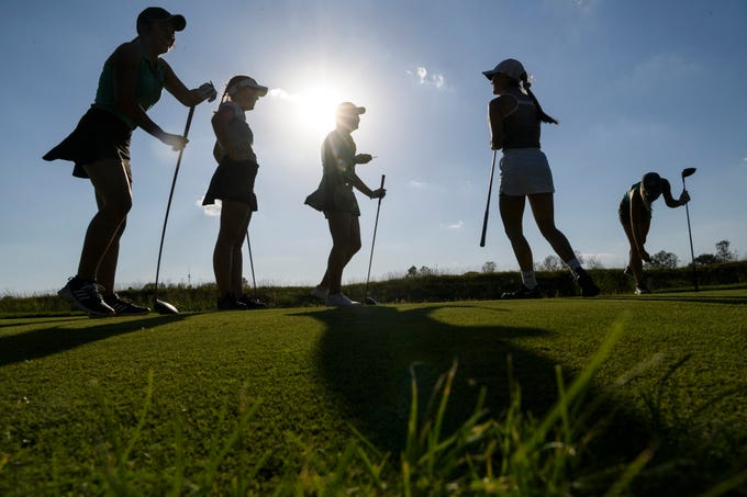North's Reagan Sohn, from left, Faith Johnson, Chloe Johnson, Destynie Sheridan and Abby Whittington practice for their upcoming state golf tournament at Victoria National Golf Club in Newburgh, Ind., Wednesday afternoon, Oct. 2, 2019.