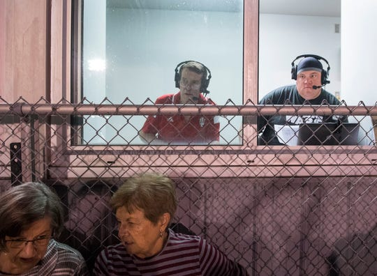 Fox Sports Radio WRCY 1590 AM broadcasters Allen Buck,  left, and Chris Cooke, right, announce the Mt. Vernon vs North Posey rivalry game in Mt. Vernon, Ind., Friday, Aug. 30, 2019.