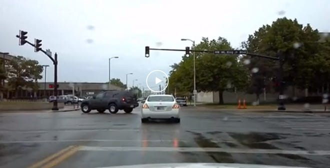This screenshot of a video posted to Reddit shows a stolen car chase in downtown Evansville.