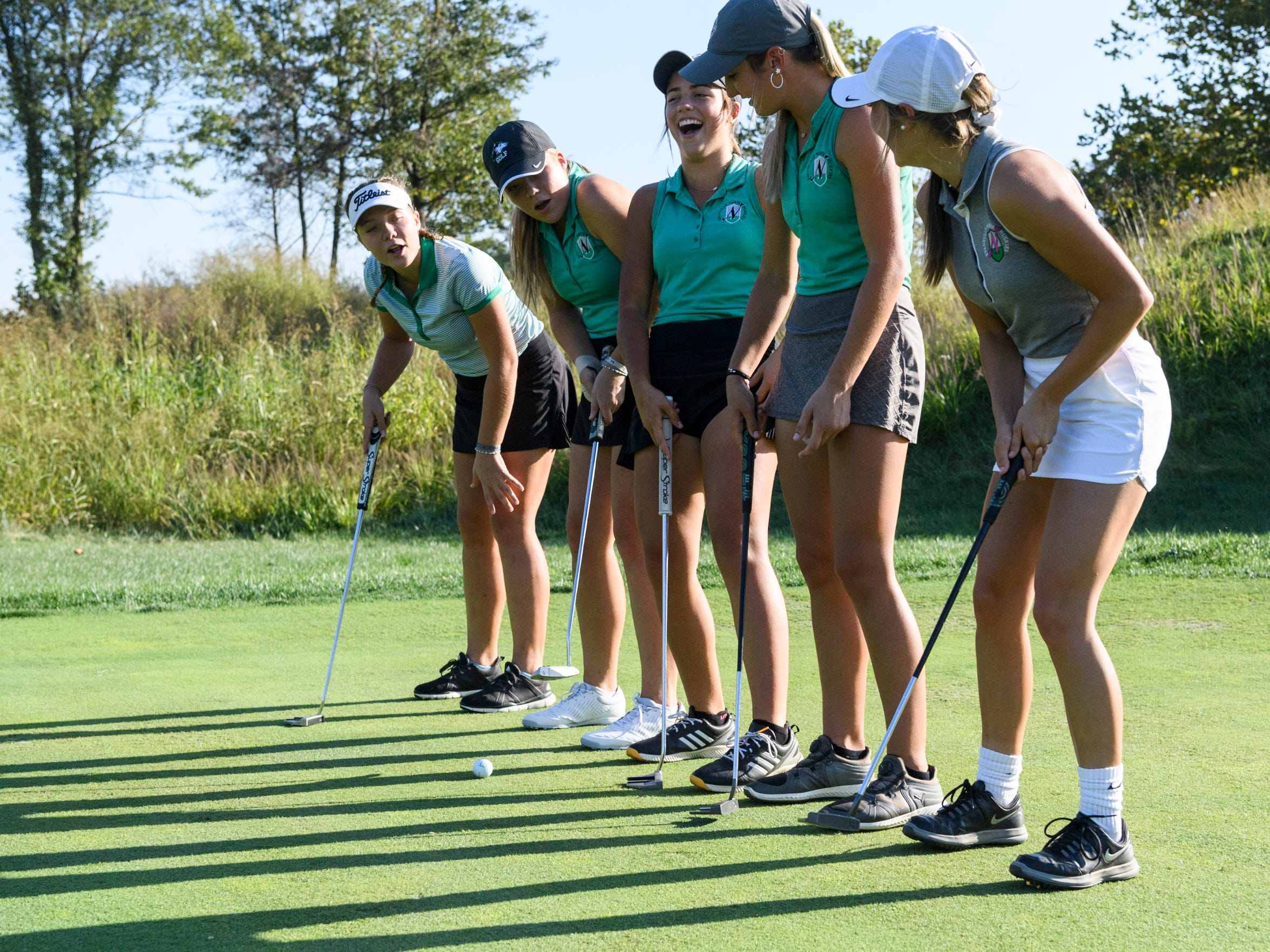 North's Faith Johnson, from back left to front right, Chloe Johnson, Reagan Sohn, Abby Whittington and Destynie Sheridan laugh as a fun drill they try doesn't go as planned during practice at Victoria National Golf Club in Newburgh, Ind., Wednesday afternoon, Oct. 2, 2019.