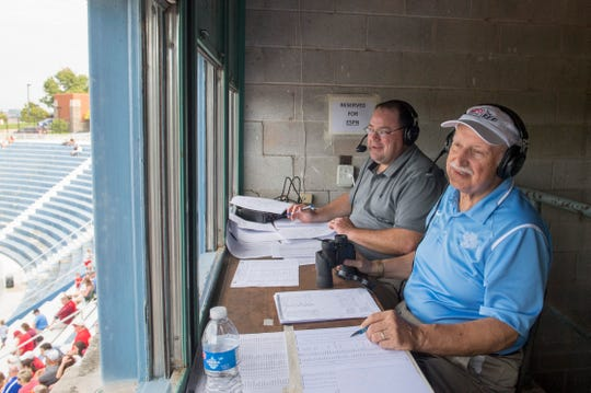 ESPN Radio WREF broadcasters, Ryan Wagler, left, and Mike Skvara, left, announce the Mater Dei vs Whiting football game at the Reitz Bowl Saturday, Aug. 31, 2019.