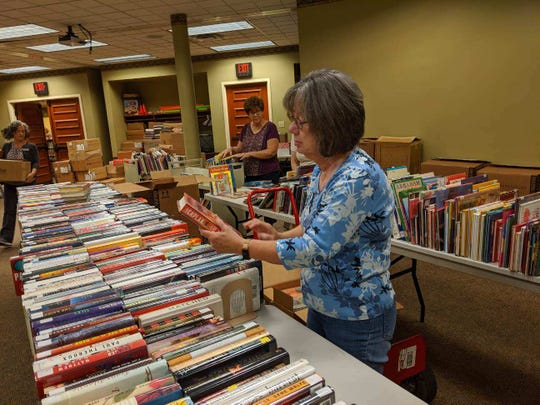 Martha Montgomery overlooks books on sale beginning Friday at the annual Friends of the Library Book Sale.